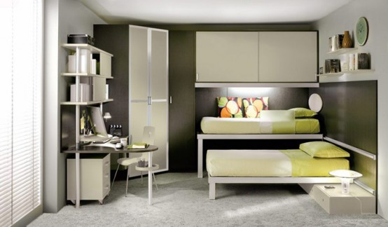 A room with a white loft bed combination that includes a